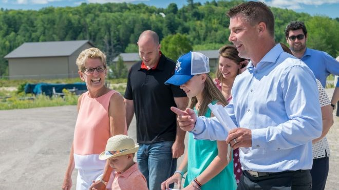 Jeff Scharf (foreground), president at Greenhouses Canada, leads Ontario Premier Kathleen Wynne (left) on a tour of his Espanola greenhouse facility in August. Photo supplied