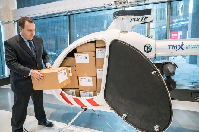 Tony Di Benedetto, CEO of Drone Delivery Canada, loads cargo into his company's newest, largest and farthest-range cargo delivery drone, the Condor, in Toronto, Ont. on Feb. 19, 2019. The 7-metre-long Condor has a payload capacity of 400 pounds and a potential travel distance of up to 200 kilometres. (THE CANADIAN PRESS IMAGES/J.P. Moczulski)