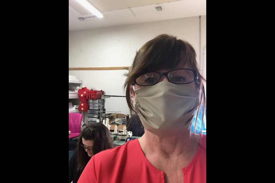 Julie Gohm,  of The Original  Bug Shirt Company in Powassan, models a mask she's fabricated following requests during the COVID-19 pandemic. (Supplied photo)