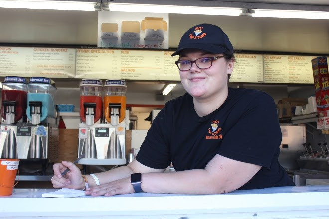 Employee Sara Gervais stands at the ready to take orders at the Riv chip stand in Sturgeon Falls. (Ella Jane Myers photo)