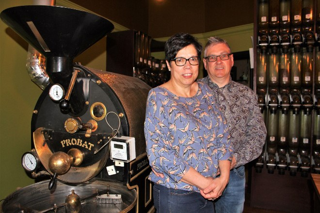 Carole Roy, left and Luc Roy pose next to their roastery and coffee selection at the Sommolier de Cafe/Old Rock roastery location on Minto Street May 26. the Sudbury-based coffee and tea business has entered into a licensing agreement to sell their coffee and tea with The Dock on Queen in Toronto, which is owned and operated by former Sudbury resident and musician Mimi O'Bomsawin. Karen McKinley photo