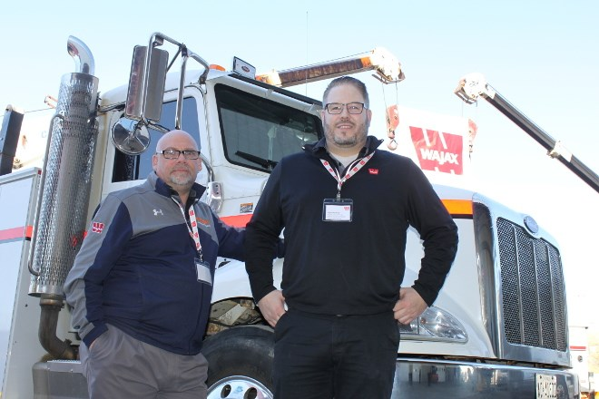 Norm Leduc (left), branch operations manager at Wajax, and Kyle Doherty, regional sales manager for Northern Ontario, recently celebrated the December opening of its new 42,500-square-foot facility in the Walden Industrial Park. (Lindsay Kelly photo)