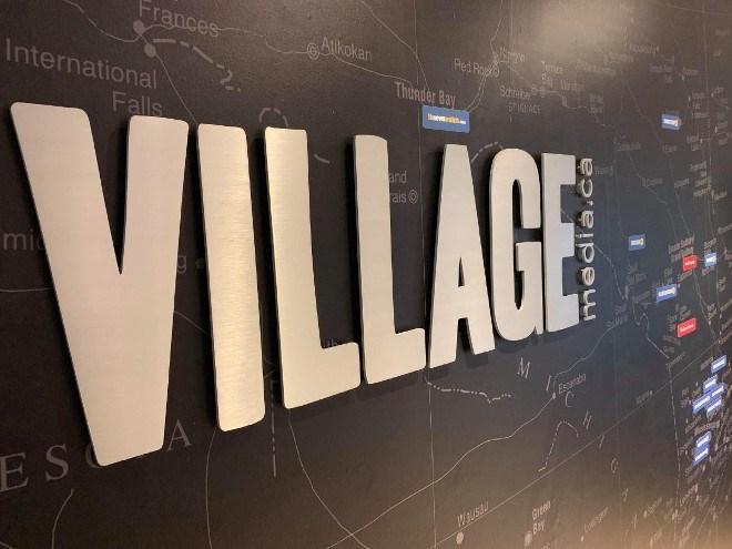 Village Media sign