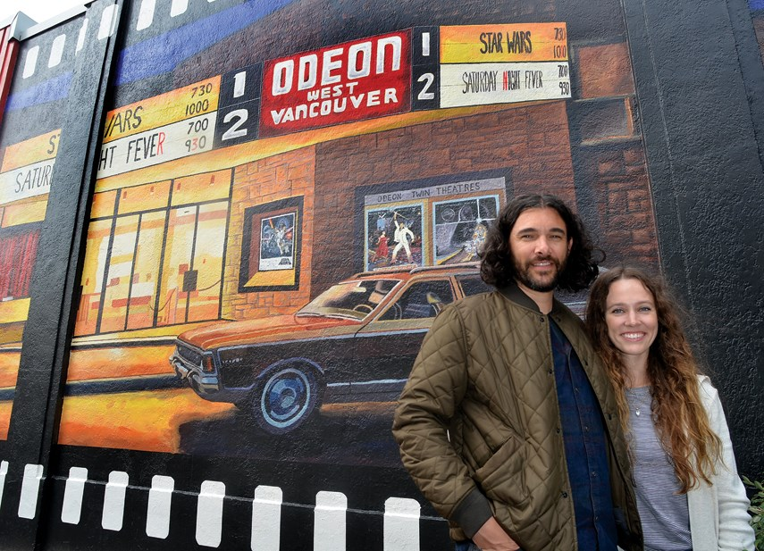 Emilie and Mike Fantuz look like they may be waiting for their show to start in front of their mural depicting the Odeon West Vancouver theatre in 1977.