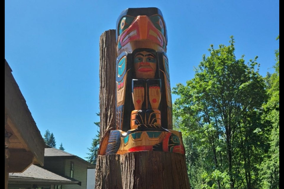 Squamish Nation artist Darren Yelton carved a totem pole into a living tree at a home in North Vancouver.