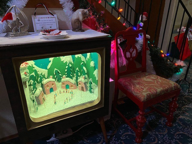 A scene from The Grinch Who Stole Christmas is depicted in miniature inside an old TV box. North Vancouver's Melanie Lane has made a number of these creations during the COVID-19 pandemic.