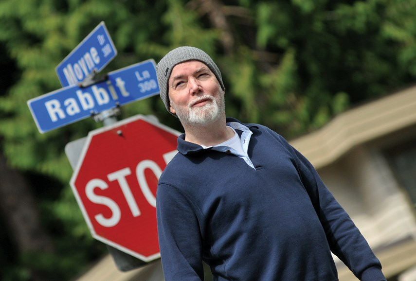Writer, artist, unofficial generation X spokesman, and West Vancouver resident Douglas Coupland stands at the corner of Rabbit Lane and Moyne Drive in West Vancouver. Coupland is seeking help from the community for an upcoming art project inspired by his 1998 novel 'Girlfriend in a Coma.'