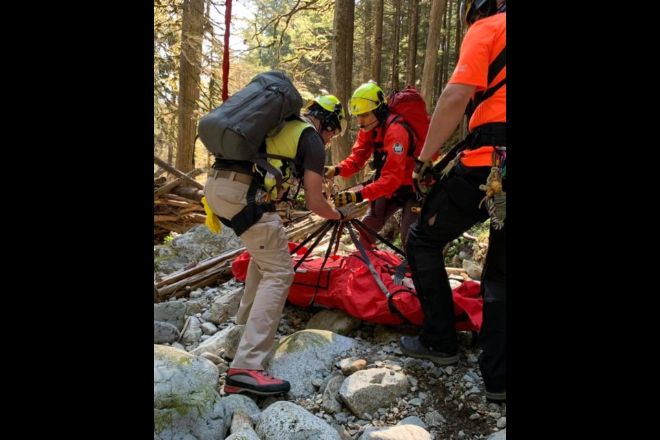 A team from North Shore Rescue readies an injured hiker for transport from Mount Seymour.