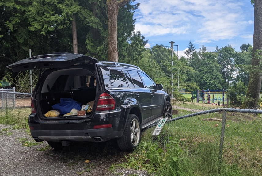 A West Vancouver parent's Mercedes SUV sits perched on the Cypress Park Elementary fence on Tuesday, June 15, 2021, after it was driven onto the schoolyard.
