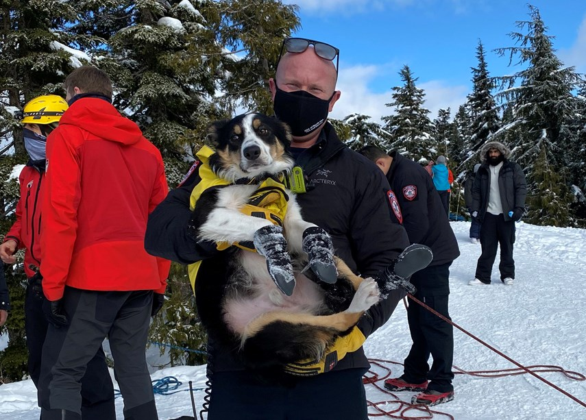 North Vancouver fire Capt. Paul Cylla is all smiles under his mask after assisting in the rescue of a stranded dog and his human.