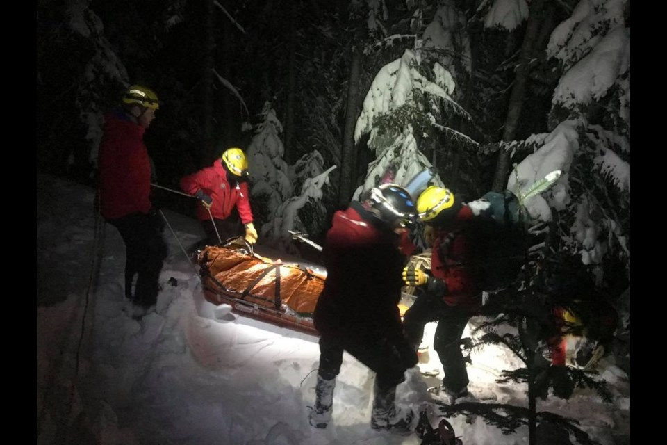 North Shore Rescue crews rescued a snowboarder who had been partially buried in an avalanche Tuesday night.