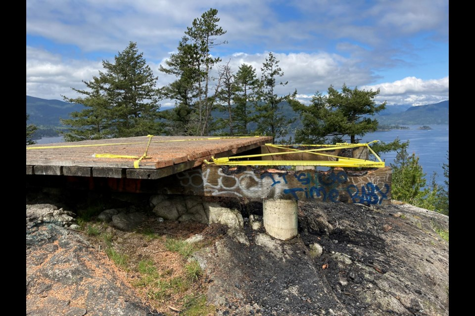 "A helipad above Horseshoe Bay is left heavily damaged by a ""careless"" fire in the night, Saturday, May 1, 2021."