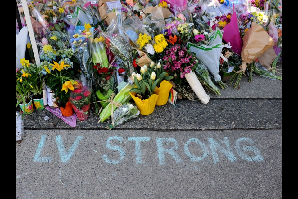 Messages of hope written in chalk blanket the plaza at Lynn Valley Village on Monday, April 5, 2021, nine days after a violent knife attack that killed one person and injured six more.
