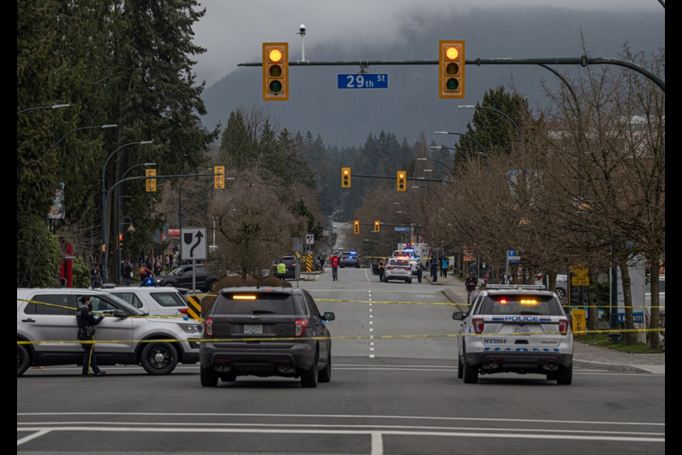 First responders cordon off the area around the Lynn Valley library complex following a mass stabbing attack the left one victim dead and six more injured on Saturday, March 27, 2021.