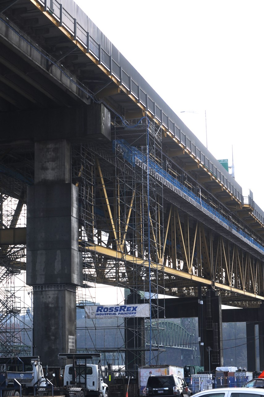 Ironworkers painting web