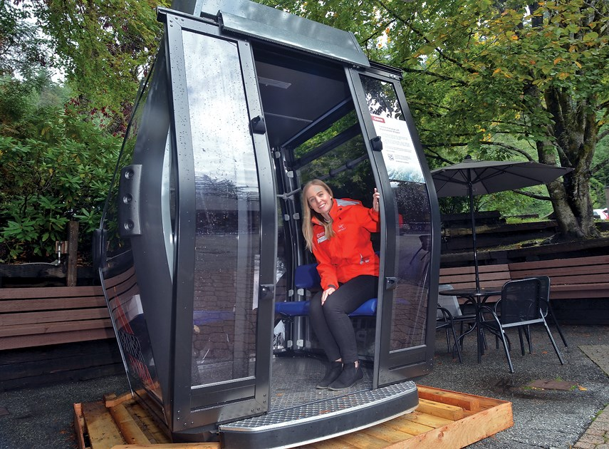 Grouse Mountain spokesperson Melissa Taylor shows off the newly proposed gondola to replace the resort's old blue tram.