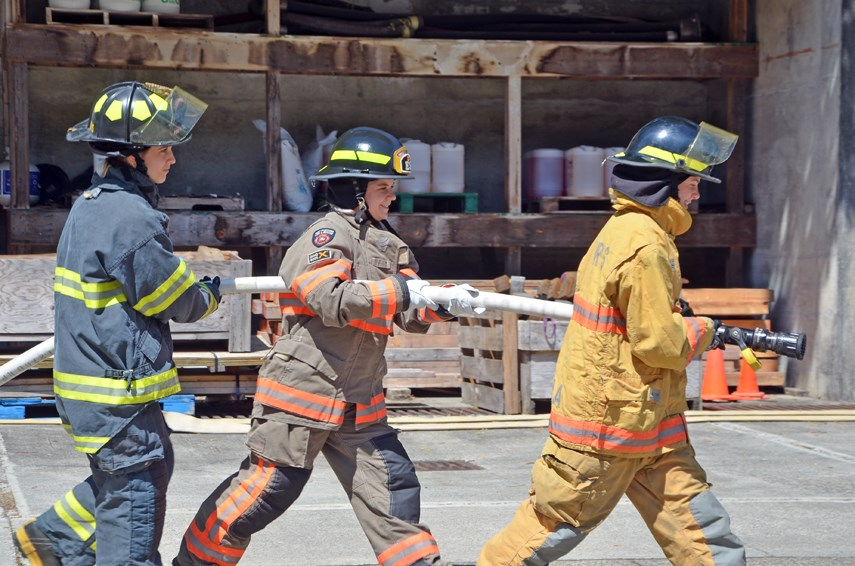 North Shore high school students Laurel Davey, Eleanor Green and Tia Harris have an opportunity to try out some of the activities they'll be doing at Camp Ignite next month, during a meet-and-greet with camp mentors held at the District of North Vancouver's firefighter training centre on July 22, 2021.