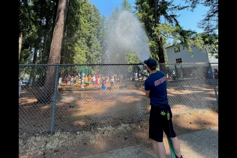 Giggles and squealswere heard atfour elementary schools in North Vancouver today as students enjoyeda much-welcomed soaking by fire hoses as they ran out of classto kick off their summer break.