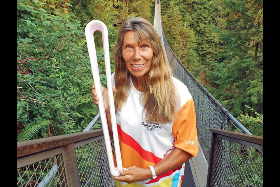 "Elaine Tanner, pictured here on the Capilano Suspension Bridge in 2017 during the Queen's Baton Relay, has a message for athletes whose Olympic dreams were dashed last year and are struggling to compete in the rescheduled games: ""You are far more than a swimmer, or a track star, or an athlete."""