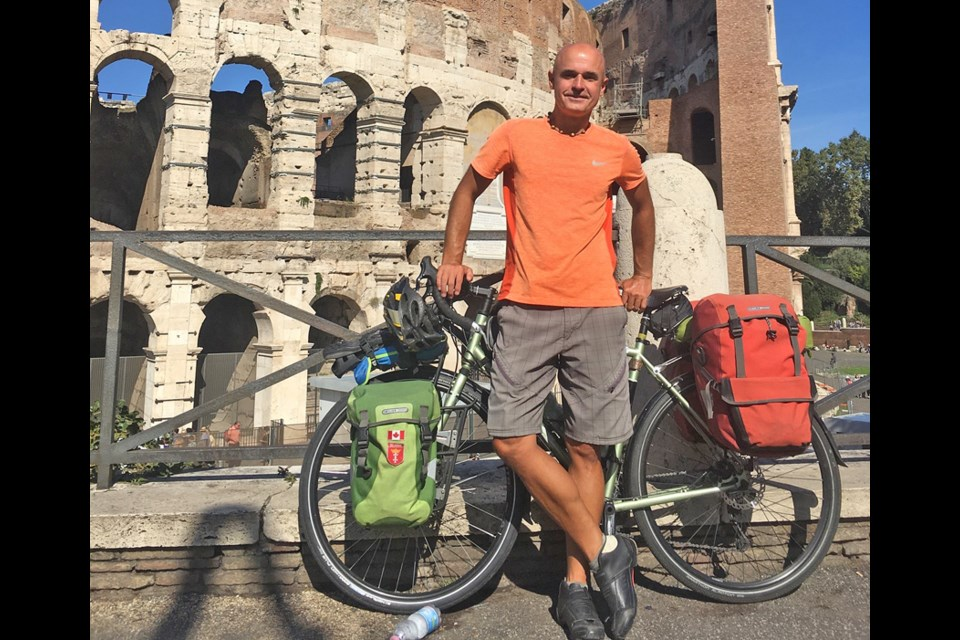 North Vancouver resident Jacek Laszkiewicz takes a break in Rome at the end of his six-month cycling trip in 2018. Laszkiewicz was recently recognized by Guinness World Records for his trip, where he set the record for the most consecutive capital cities visited by bicycle.