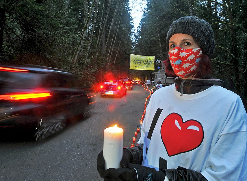 Lynn Valley resident Jen Barsky was one of the many volunteers helping out at the Lynn Valley Drive Thru Candlelight Vigil at Lynn Canyon Park in tribute to the recent stabbing attack at Lynn Valley Village. Hundreds of vehicles lined up to support and pay respects.