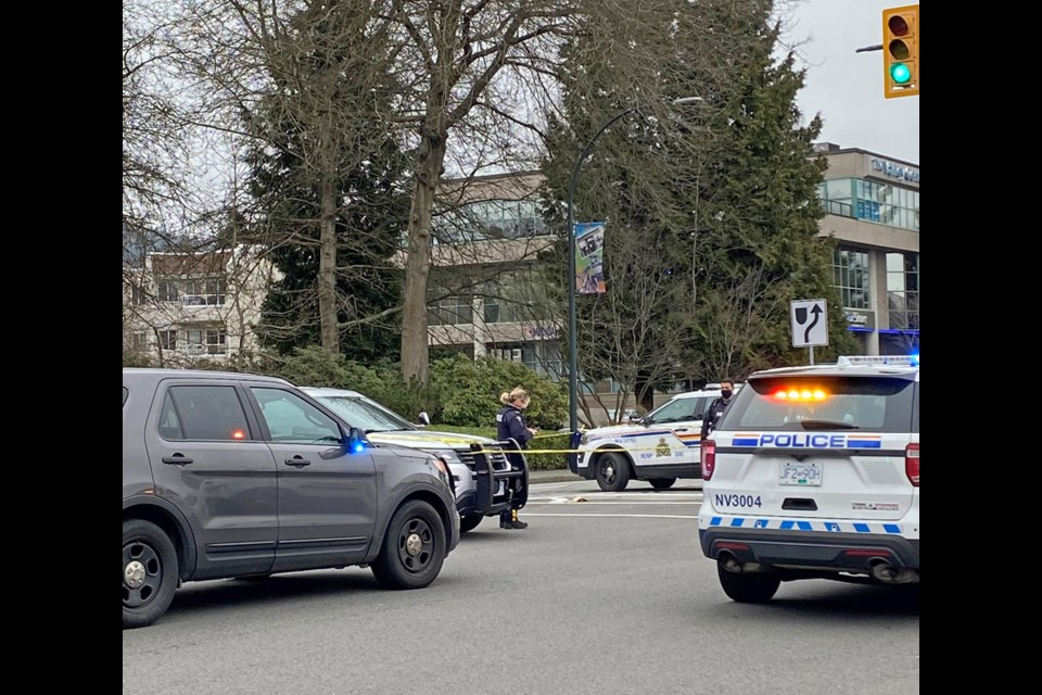 Police cordon off the area around the Lynn Valley library following stabbing attacks on seven people March 27.