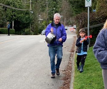 Paul Weir and his grandson Cooper lead the cheer on Coleman Street in North Vancouver. The street has cheered for pandemic frontline workers every single night at 7 p.m. since March 28, 2020.