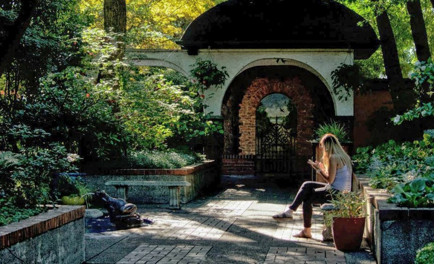 A person relaxes in Park & Tilford Gardens during sunnier days. The popular North Vancouver spot has been closed since November due to the pandemic.