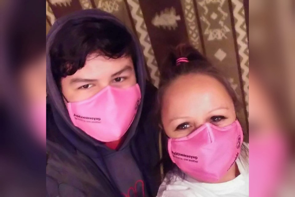 Squamish Nation community members show off their pink masks to mark Canada's Anti-Bullying Awareness Day - Pink Shirt Day.