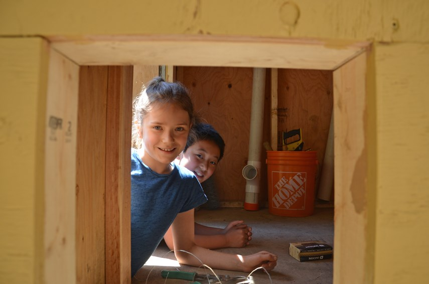 Waldorf School students Briar and Quinten poke their heads inside the chicken coop they and their classmates at the Lynn Valley school have been building this year.