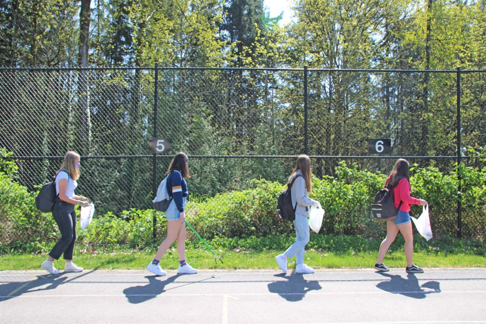 Students at Windsor Secondary walk the perimeter of the track during an Earth Day clean-up initiative on Thursday, April 22, 2021. The school district has launched a community clean-up campaign this week that wraps up on May 31.