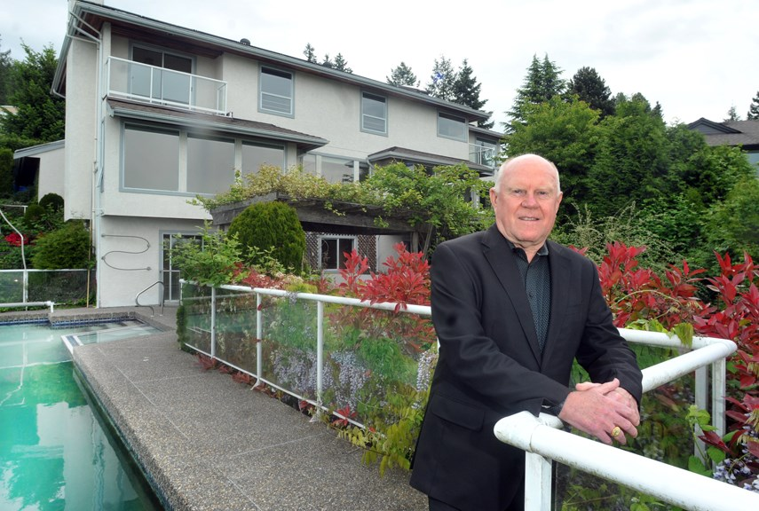 Real estate agent Calvin Lindberg of Angell Hasman and Associates, attends one of his listings in West Vancouver on Monday, May 17, 2021. The local real estate market is hot again this year.