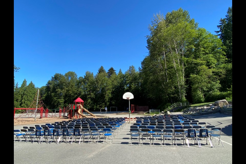 Two hundred and fifteen chairs line the playground at North Vancouver's École Braemar Elementary on Tuesday, June 1, 2021. The installation follows news of the mass grave of 215 children at the site of the former Kamloops Indian Residential School.