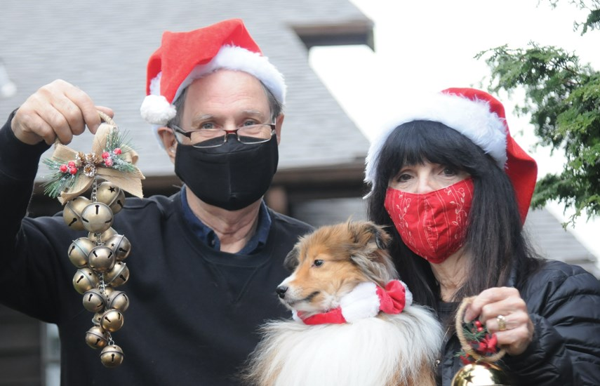 North Vancouver's Colin and Laurel Gurnsey and their Shetland sheepdog Keira are ready to ring bells on Christmas Eve, hoping others will follow. The worldwide event happens at 6 p.m. local time on Dec. 24, 2020. photo Mike Wakefield, North Shore News