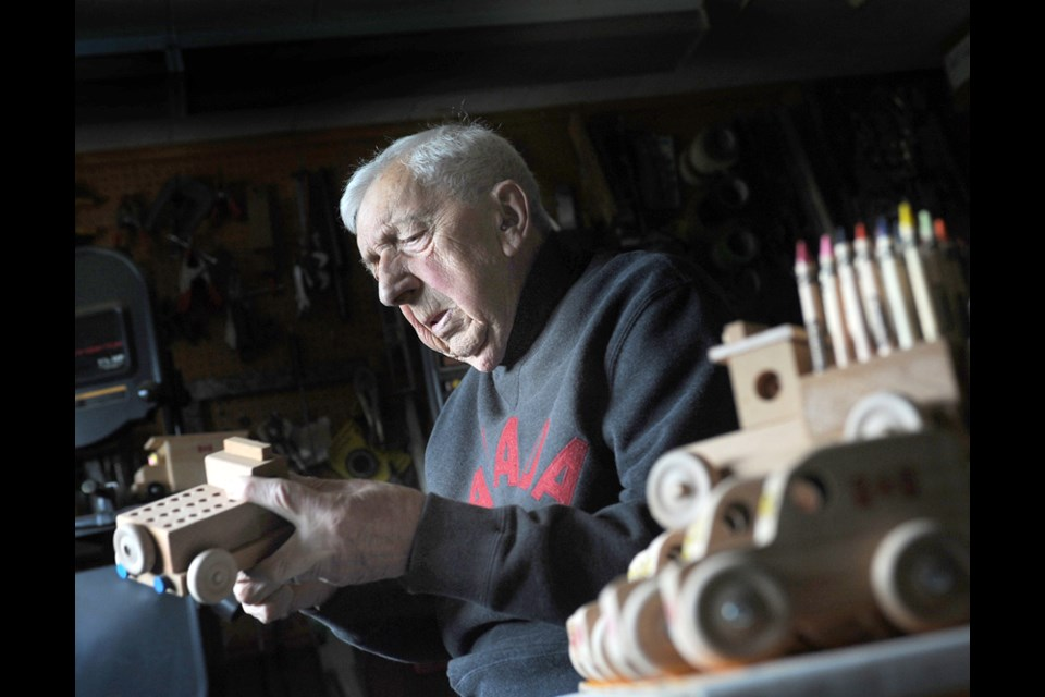 Toymaker Bill Chalmers, age 90, has been making wooden toys for North Vancouver Family Services Christmas Bureau for 27 years. Here he is in his workshop in November, 2020.