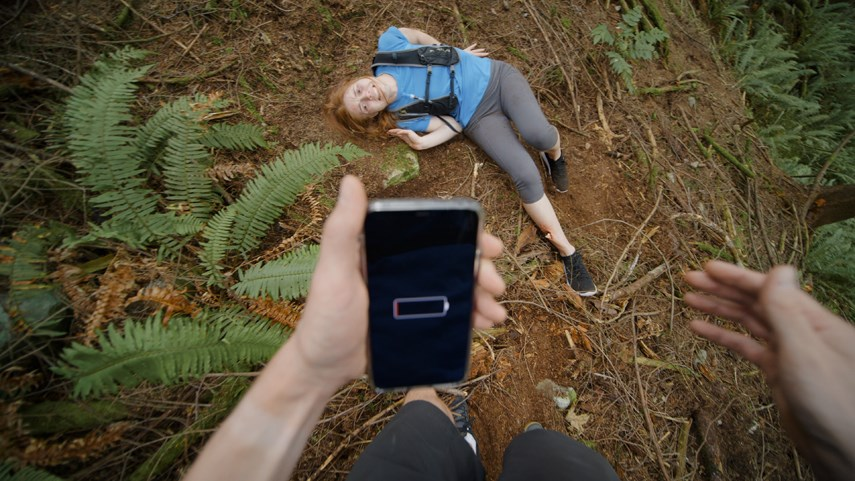 The unnamed central character of North Shore Rescue's 'Survive your own adventure' video attempts to call for help only to find his phone's battery is dead.