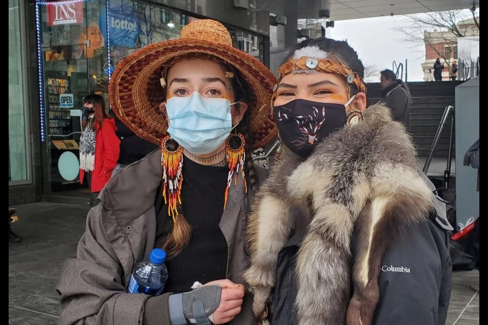 Braided Warriors Scwicweye and Kaylee Wolflinger stand outside the Chubb Insurance building at 250 Howe St. in downtown Vancouver on Monday, March 1.