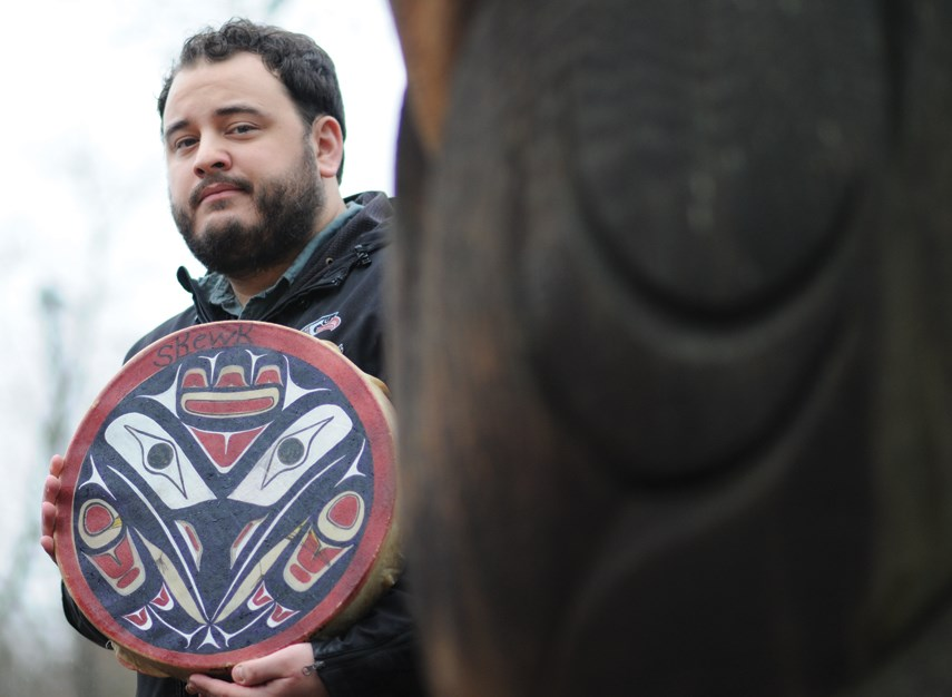Jullian Kolstee holds a depiction of Skewk, the raven, in tribute to his father Anton. A beloved teacher and ally for Indigenous students at Carson Graham Secondary, Anton died of COVID-19 on Dec. 8, 2020.