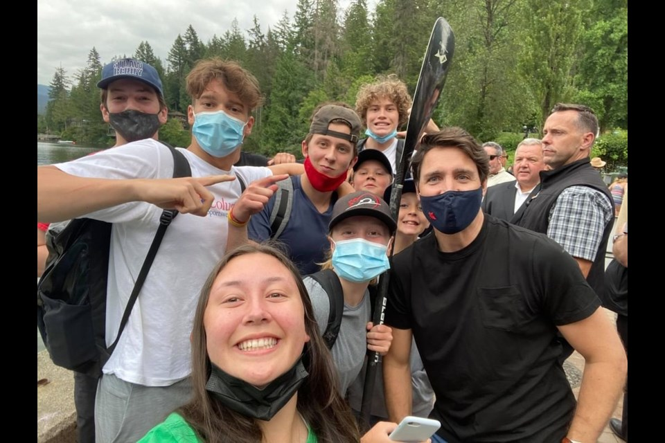Justin Trudeau stops for a selfie with visitors outside Deep Cove Kayak in North Vancouver July 8, 2021.