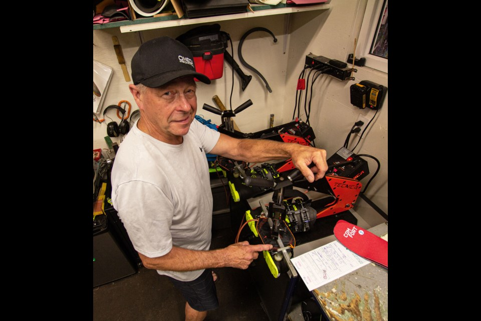 Paul Zirk, founder and owner ofThe Destination Slope & Surf Outfitters, working on a custom boot-fitting.