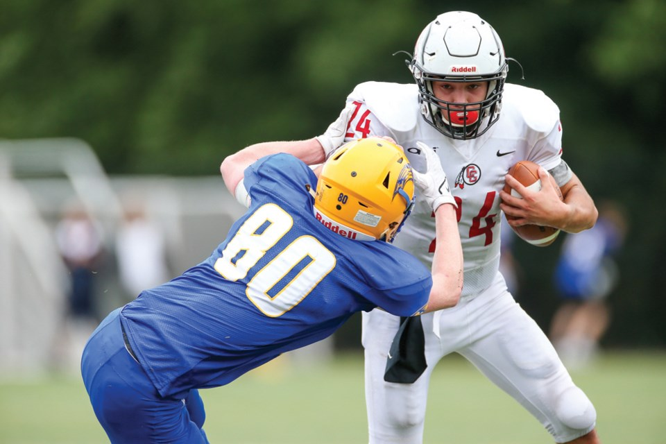 Carson Graham quarterback Logan Mellish fights through a tackle from Handsworth's Connor Smith in the Buchanan Bowl played Friday at Confederation Field. Mellish was named player of the game as the Eagles won 46-28.