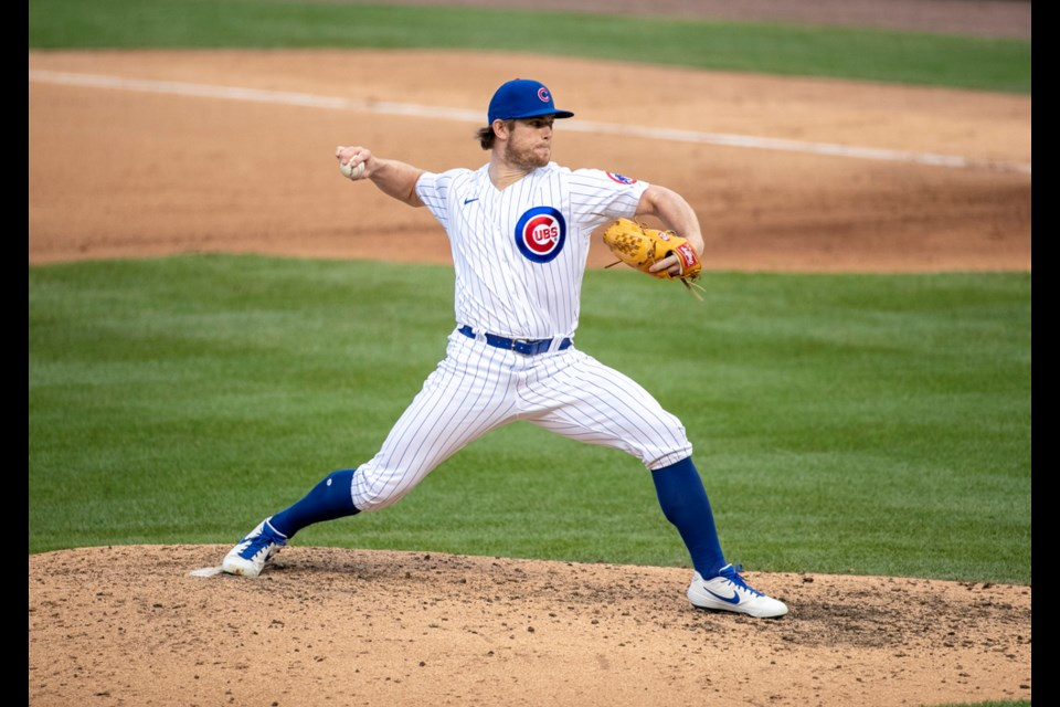 North Vancouver's Rowan Wick fires a pitch for the Chicago Cubs at Wrigley Field during the COVID-shortened 2020 season.