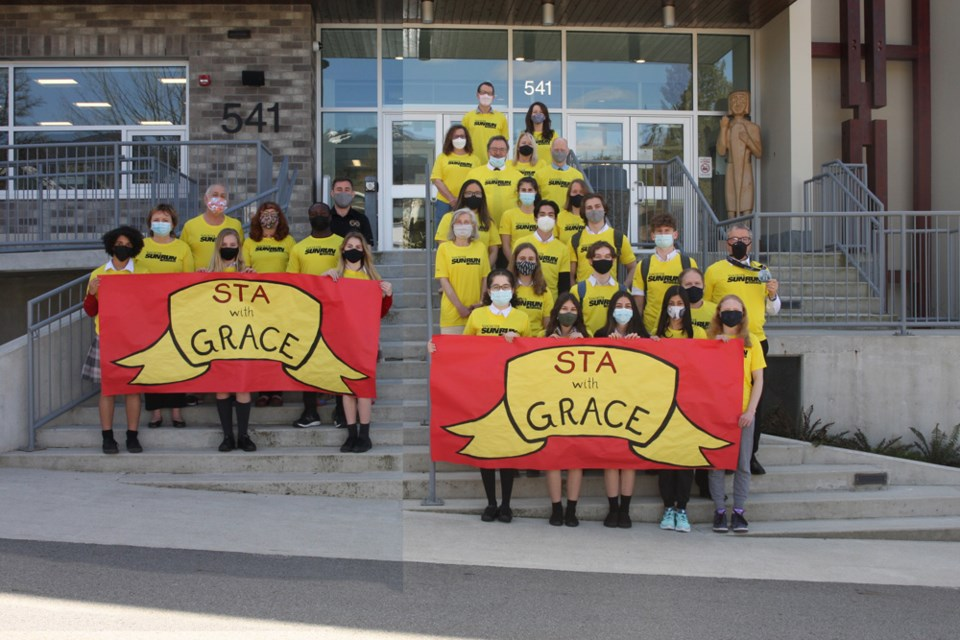 Members of the STA With Grace running team get ready for the Vancouver Sun Run. The team is running in honour of Grace Haines, a classmate who was seriously injured in a hit and run collision in January of 2021. (Note this photo is a composite image due to the school's COVID restrictions).