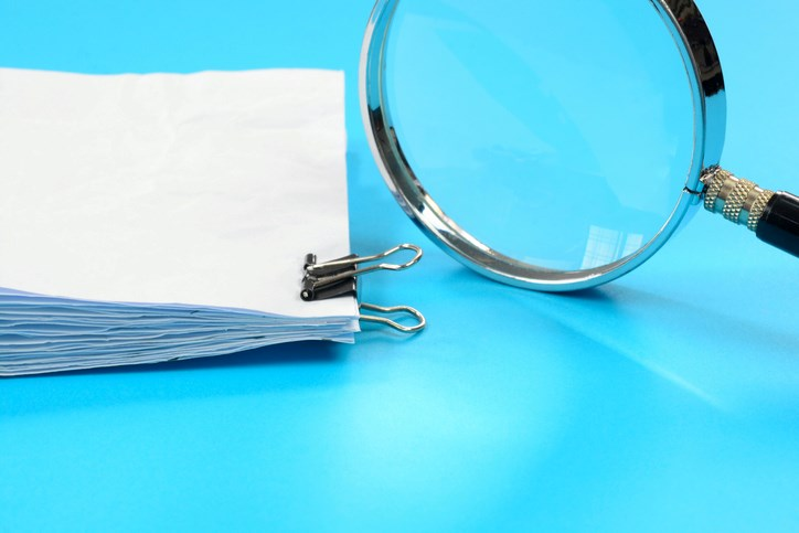 paperwork & magnifying glass