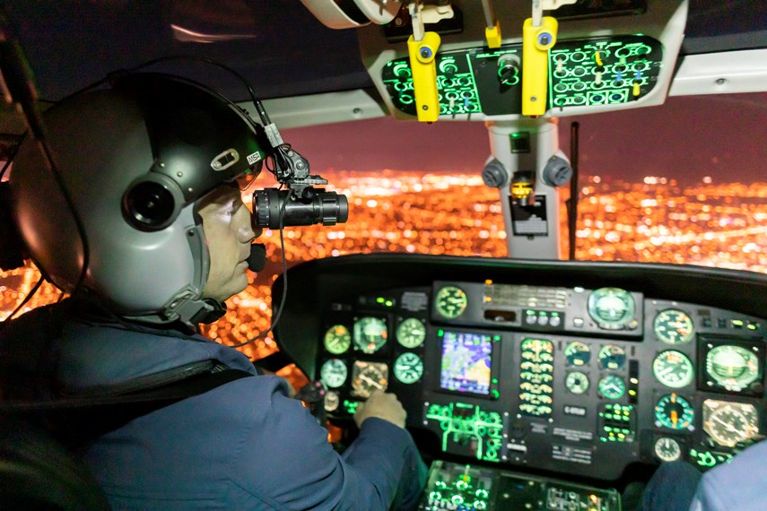 Talon Helicopter pilots Kelsey Wheeler, left, and Jarrett Lunn use NVG while flying Talon's Airbus AS365N2 Dauphin back to their base at Vancouver airport. photo Heather Moffat