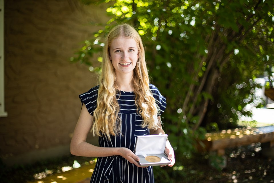 Turner Valley teen Hope Roberts poses on Aug. 1 with the Queen's Golden Jubilee Citizenship Award that she received from Lieutenant Governor Lois Mitchell at Government House in Edmonton on July 23. (BRENT CALVER/Western Wheel)