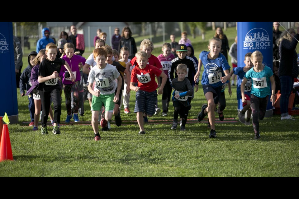 The youngsters take off for the start of the 2km run at the Big Rock Runners' Sheep River Road Race Sept. 14 at the Foothills Centennial Centre. (Bruce Campbell/Western Wheel)