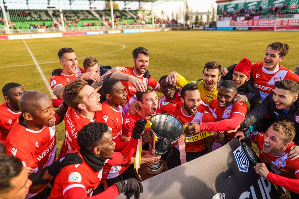The Cavalry FC players cheer after being presented the Wildrose Cup in the last regular season game against FC Edmonton at Spruce Meadows on Oct. 19. After a goalless first half, the Cavs scored three in the last 20 minutes, with Edmonton getting one in as well for a 3-1 finish the fall competition in first place. (BRENT CALVER/Western Wheel)