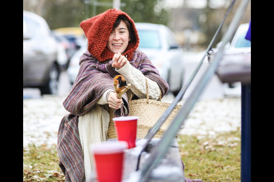 Janine Arellano scatters a goblin's cup of gold coins with her slingshot as part of a quest during Enchanted Okotoks on Oct. 26. (BRENT CALVER/Western Wheel)