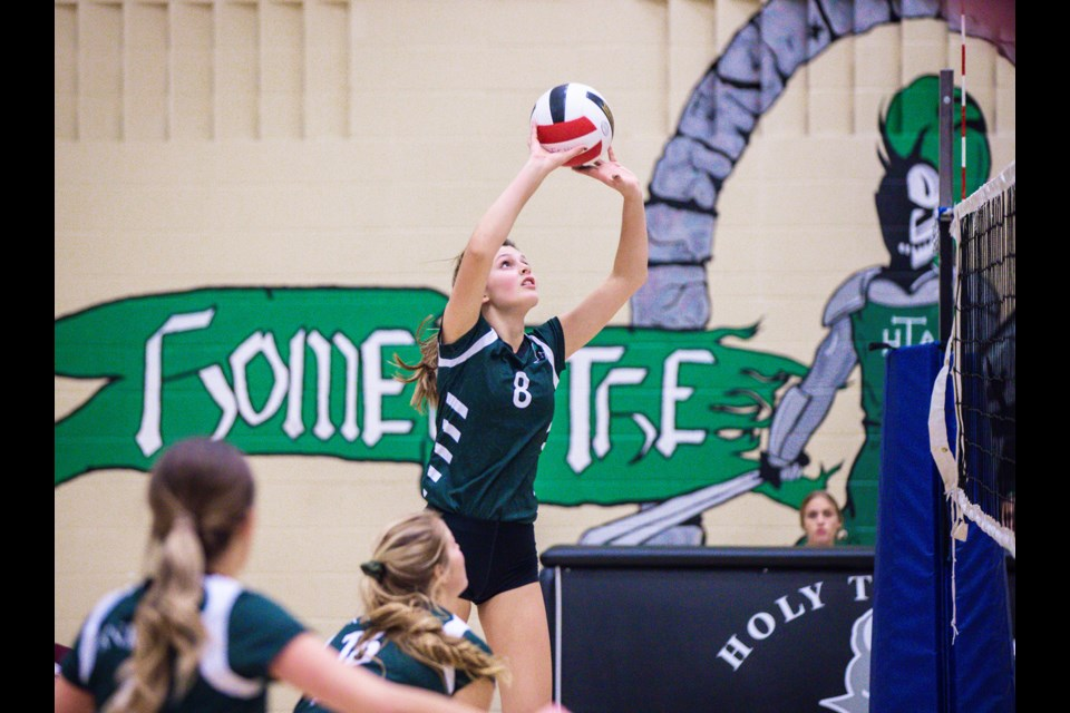 Holy Trinity Academy Knight Kylee Glanville pushes the ball back over the net against the Foothills Falcons in the Foothills Athletic Council Sr. girls volleyball final Nov. 6 at HTA. The Knights took the title with a narrow 3-2 victory.  (BRENT CALVER/Western Wheel)